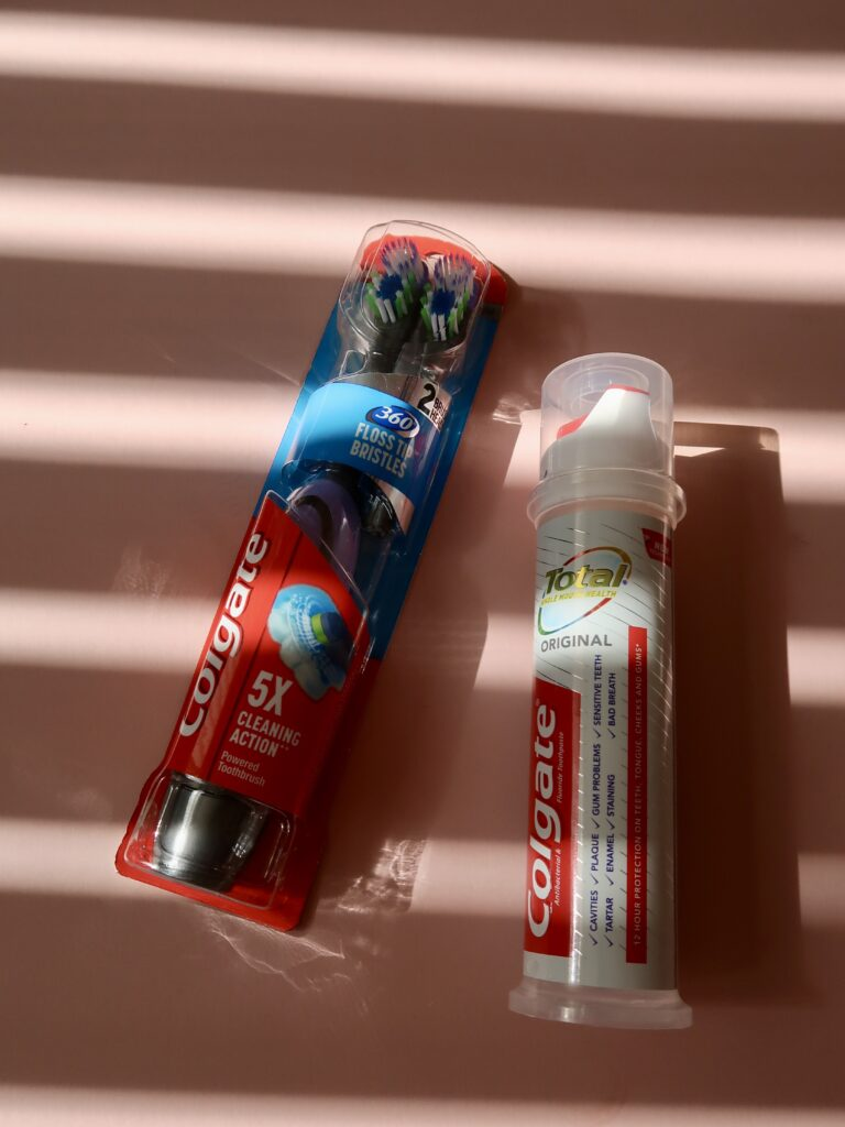 flatlay of toothbrush and toothpaste